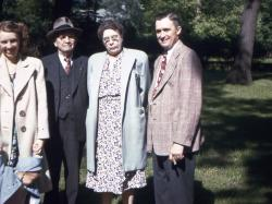"Mildred holding Bob, Jr.'s hand, Harry F. and Jenny Gross, with Harry holding ""trademark"" cigar."